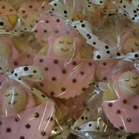 Baby In A Blanket These were favors for a baby shower. Similar to the babies in blankets cupcakes in the Wilton Yearbook.