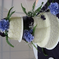 Andrew's Cake Fondant covered cake with BC accents and purple roses.
