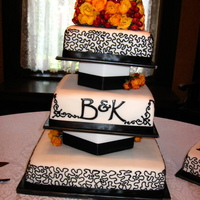 Black And White With Roses This was a wedding cake for a friend. She wanted a strong graphic quality to the cake, and was thrilled with how it turned out.