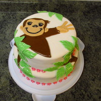 Curious George Cake done for a friend's daughter's third birthday- note that Curious George is holding up three fingers...