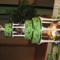 Kyla's Cake Fondant covered cake with royal icing flowers and fountain.