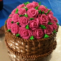 Basket Of Roses A basket of roses I did for a retiring nursing supervisor. * in rounds with half ball pan on top.