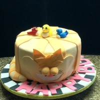 A Cat Lover's Birthday Cake first attempt at tapering a cake--had a little trouble, was able to save it but lost much of the tapering effect. fondant covered cake and...
