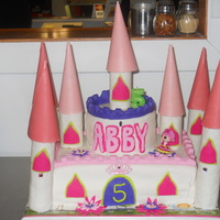 Princess Castle Strawberry and white cake covered in fondant with fondant accents. Also accented with a few plastic jewels. Towers are fondant-covered RKT...