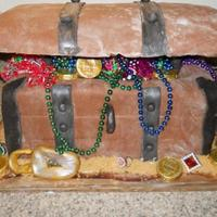 Treasure Box Cake Cake made of alternating layers of yellow and chocolate cake, covered with chocolate fondant and fondant accents. Jewels consist of...
