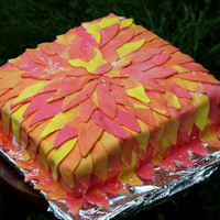 Fire Flower This is a white cake with lemon filling covered with a coat of buttercream and covered with marshamllow fondant. The fondant is cut out...