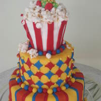 Circus, Carnival Themed Cake  All fondant with fondant decorations. I found the ideas for this cake on this site..thanks!popcorn is mini marshmallow painted with brown...