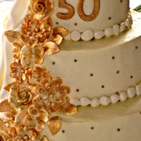 Golden Anniversary   Buttercream with gold painted sugar flowers