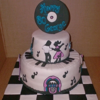 50's Themed Birthday 10 inch triple layer with a 6 inch triple layer, covered in MM fondant and royal icing decorations