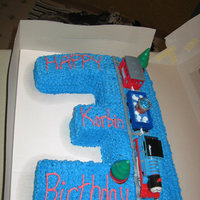 Thomas The Train Cake Made this for a friend's son for his 3rd bday. Frosted in b/c. Real train on top was the boy's gift.