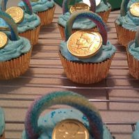 St. Patricks Day Cupcakes Gold choc coin, sugar coated rainbow candy, gold foil cupcake liner & b/c frosting