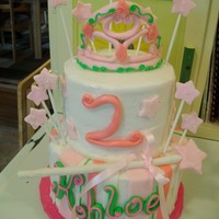 Princess Two tiered princess cake. Tiara and want made from gumpaste. Stars, wand, and tiara has sparkles.