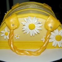 1St Purse Cake   inspired by a photo from tanyascakes. vanilla/strawberry swirl with vanilla bc, fonderific fondant. Fun to make. TFL