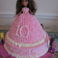 Doll Cake I was asked to make a doll cake for a 10 year old. I made the doll cake and 20 mini cakes for her guest. Butter cakes and buttercream....