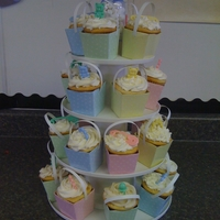 Baby Shower Cupcake Tower Vanilla cupcakes with cheescake, strawberry and lemon meringue fillings with buttercream frosting. I found these cute little boxes at the...