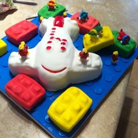 Lego Birthday Cake My grandson 4th birthday cake. Butter cake with buttercream frosting and covered in fondant. Lego men are chocolate.