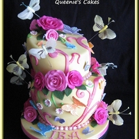 Butterfly & Rose Topsy Turvy 6>4 and 7>5 vanilla nut cakes filled with vanilla buttercream. Covered in fondant and decorated with gumpaste roses, edible...