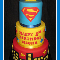 Superbaby 1St Birthday   5-7-9in. All fondant decoration.