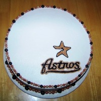 Astros Cake Double chocolate cake with vanilla buttercream. RI logo and fondant accents.