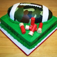 Camo Football Hunting Cake chocolate cake with camo buttercream football, rifle shells are fondant