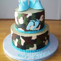 Baby Shower Cake vanilla and chocolate cake, camo buttercream to match invites. Baby booties are gumpaste.