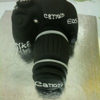 Canon Camera Cake It was fun making this camera cake. It's made of plain vanilla cake and fondant. TFL.