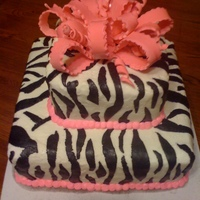 Zebra Cake buttercream icing, rolled buttercream zebra stripes, fondant bow