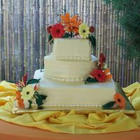 "Tiffany's Wedding Cake WASC with Raspberry BC. A 6"" square top, 10 inch round middle and 14"" square . Contained handmade gumpaste/fondant Yellow, Orange..."