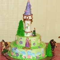 Rapunzel Cake Niece Isabel's cake. Covered in buttercream, flowers are gumpaste, trees are icecream cones covered in royal icing, tower is made of...