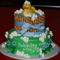 Ducky Baby Shower Cake Covered in buttercream. Bucket is made from placing cookies around the layer and covering top with piping gel . Bubbles are luster dusted...