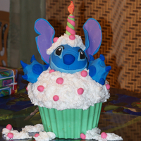 I Made This Cake For My Sister Who Is A Huge Stitch Fan The Head Is Made Of Rice Cereal The Cupcake Wrapper Is Candy Melts And The Ears I made this cake for my sister who is a huge Stitch fan. The head is made of rice cereal. The cupcake wrapper is candy melts, and the ears...