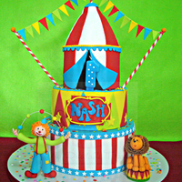Nash's Circus Themed Cake I had fun making this cake and this is my first circus themed that I made :). The clown, Lion and buntings are all made out of gumpaste. I...