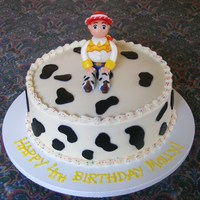 Jessie - Toy Story Cake   BC with fondant cow print spots, and fondant Jessie. I really had fun making her!