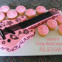 Rocker Girl Cake   Buttercream with fondant accents and silver dragees.