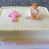 Little Angel Christening Cake   Buttercream with cake sparkles, fondant angel, cross, and flowers.