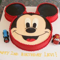 Mickey  This was inspired by CareyI's Mickey Mouse cake! Mickey is decorated all in BC. Marshmallow fondant Thomas and Lightning McQueen....