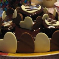Happy Hearts Day Small 3-tier cake - dark chocolate cake covered with semi-sweet ganache surrounded by homemade milk & white chocolate hearts.