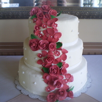 Gumpaste Roses Wedding Cake Vanilla cake, Italian meringue buttercream icing, filled with vanilla mousse and fresh strawberries. Fondant covered, gumpaste roses....