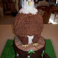 "Eagle On Stump Cakes I made this as an entry for the local fair. The theme is 'birds of a feather'. All pound cakes, 2-9"" rounds; 2-6""..."