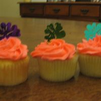 Luau Cupcakes Made for a little get together, white cupcakes with buttercream. The flowers are big confetti pieces. They worked really well! Sorry for...