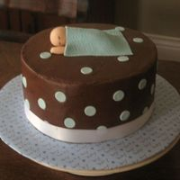 Sleeping Baby Chocolate cake/frosting, fondant polka dots, baby and blanket. Thanks for looking!