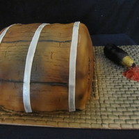 Barrel Cake Was a red velvet cake with fondant which was air brushed.