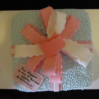 Present Vanilla chiffon with classic american buttercream. Buttercream cornelli lace and fondant bow.