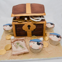 Pirate Treasure With Pirate Cupcakes   Made a treasure cake for the birthday party and some pirate cupcakes without milk and wheat for my son.