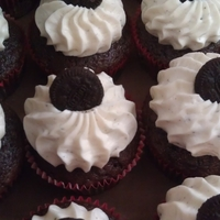 Chocolate Oreo Cupcakes chocolate oreo cake with oreo buttercream frosting and filling topped with mini oreo