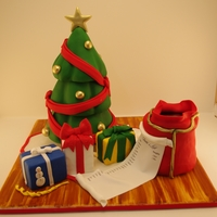 Oh Christmas Tree!!  All edible christmas tree, presents made out of rice crispies, santas bag is also cake.Flavors were chocolate cake and vanilla cake with...