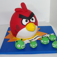 Angry Birds Cake This cake was made for my son's 5th birthday . This is a cake of the red angry bird and the piggies.
