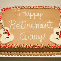 Retirement Cake Devils food cake with chocolate buttercream icing with white chocolate candy guitars.