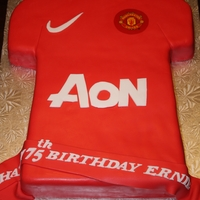 Manchester United Jersey... A lemon cake with pineapple filling, covered in fondant with accents in fondant...