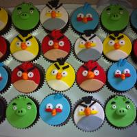 Angry Birds Cupcakes   Chocolate cupcakes with chocolate frosting. All birds hand cut of fondant!